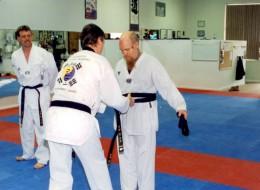 John receiving his black belt in karate.