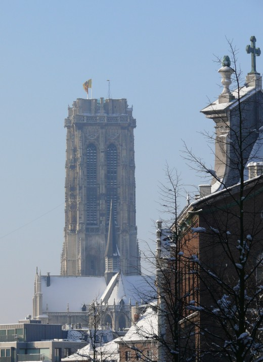 The flat-topped silhouette of the St-Rumbold's Cathedral's tower, Mechelen