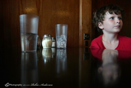 This is a photograph of one of my children taken while we waited for our pizza in a restaurant.  The glass was half full on the table and made an excellent picture for this hub.