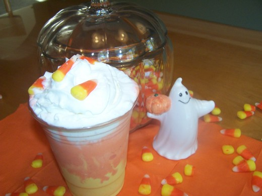 Layer the 3 colors of ice cream into clear plastic cups or glasses. Put yellow on the bottom, then orange, and finally a layer of vanilla. Freeze to eat later and then add whipped cream and candy corn or other Halloween candies or sprinkles.