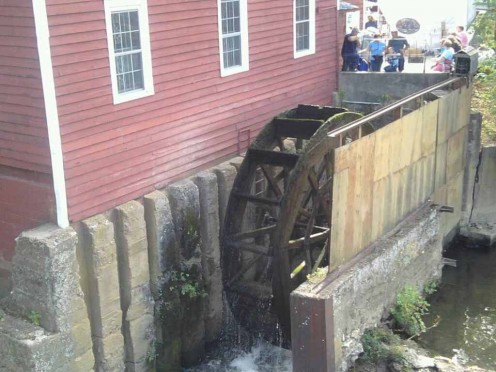 The water wheel that turns the grist mill machinery.