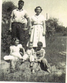 A family photo taken one Sunday at my grandparents a few years after we had moved from the mountain to the mill village. I am the one wearing overalls and barefoot.