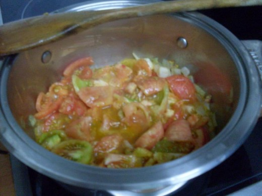 add chopped tomatoes to pan