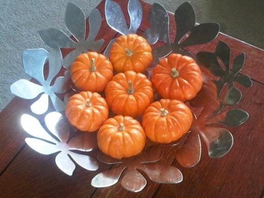 Pretty bowl of baby pumpkins.