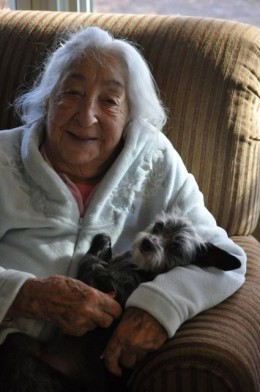 Mom is always holding one of the little girls in her arms. Here, she and Gizmo are having a little love fest.