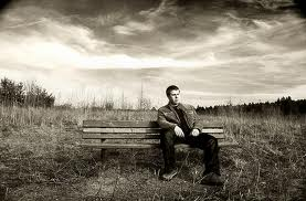 A man who was stood-up by a pretty girl can only ffind peace by himself, his thoughts, on a deserted park bench with dark clouds to keep him company.