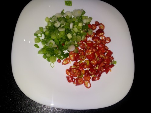 sliced spring onions and chilies