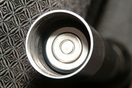Duracell C Battery inside Flashlight Tube