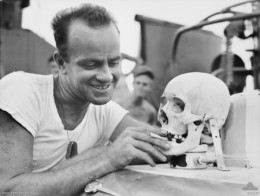 An American serviceman with a cleaned Japanese skull. The practice of sending home enemy skulls was so prevalent, the military eventually forebode doing so with a written order.