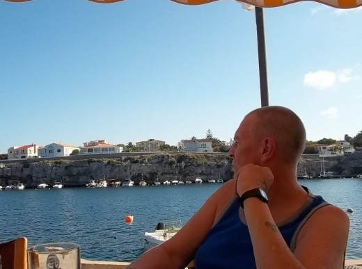 Hubby drinks in the view and a beer at Cales Fonts