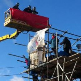 Police reach the heights in a cherry picker to arrest demonstrators at Dale Farm Oct 19