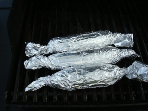 Corn Cobs Wrapped in Aluminum Foil (The corns were husked, immersed in water and wrapped in aluminum foil.)