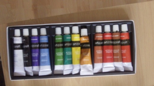 My very cheap acrylic paint starter kit which cost me £1.99 at Home Bargains in the UK, not sure about the price range of other Countries though.