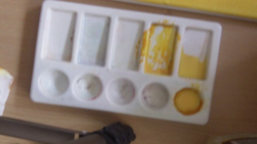 Painting Pallette with the Yellow Ocre paint mixed with a dash of water for the glaze!
