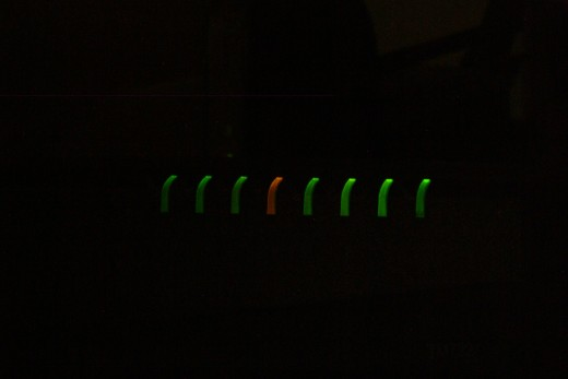 Dark and eerie glowing green LED indicator lights