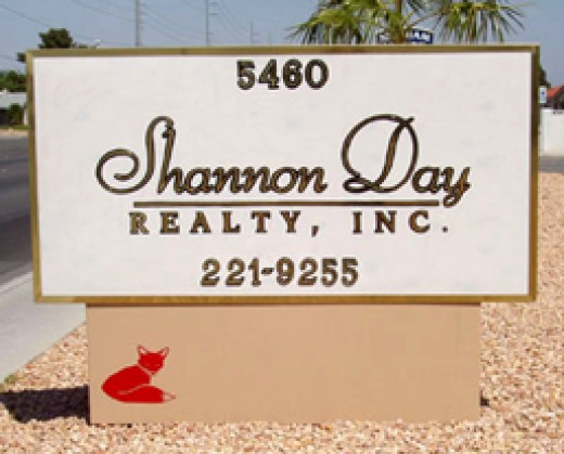Shannon Day Realty sign, with the little red fox on the sign.
