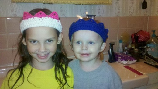 My kids, in a crocheted tiara and crown!