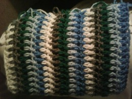 Baby boy blankie Side B-Done as a DC (double crochet) through every other row.