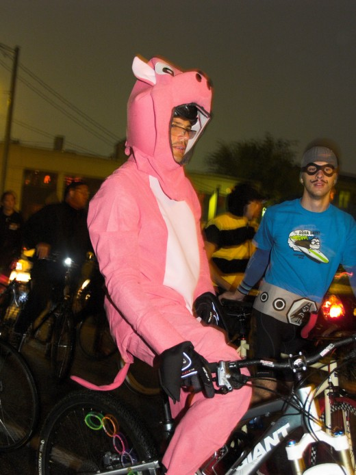 Bright bike wear. Can't miss it! But ruh-roh... where's your helmet, Mr. Piggy?