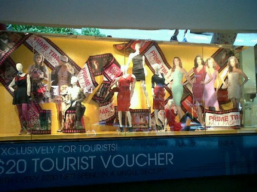 window displayed branded attire on Orchard Road.
