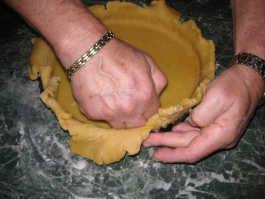 Carefully Re-Mould The Pastry Inside the Dish Using Your Knuckles or Fingertips.