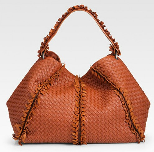 Nothing says fall like the rusty orange hue of this luxurious yet highly functional hobo bag.