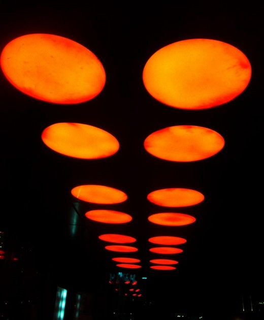 Overhead exterior lighting gives the impression of  flying saucers
