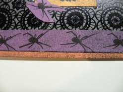 A row of spider rubber stamp images