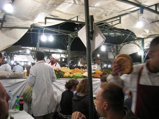 Dine in the centre of Djemaa el-Fna.