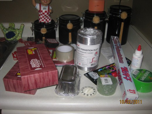 Supplies 2 Tissue boxes, 2 foil pans, timer knob off old timer, floral circle, packing tape, dryer tubing, 27 ft foil, battery operated lights, glider foam, mailbox reflectors, super glue and neon duck tape