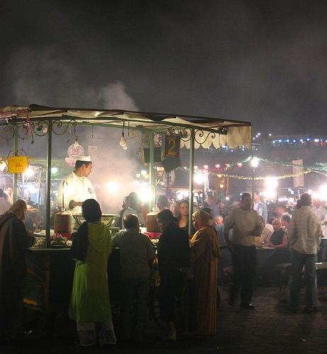 Stalls lining the edge of Djemaa el Fnaa serving Snails in garlic sauce.