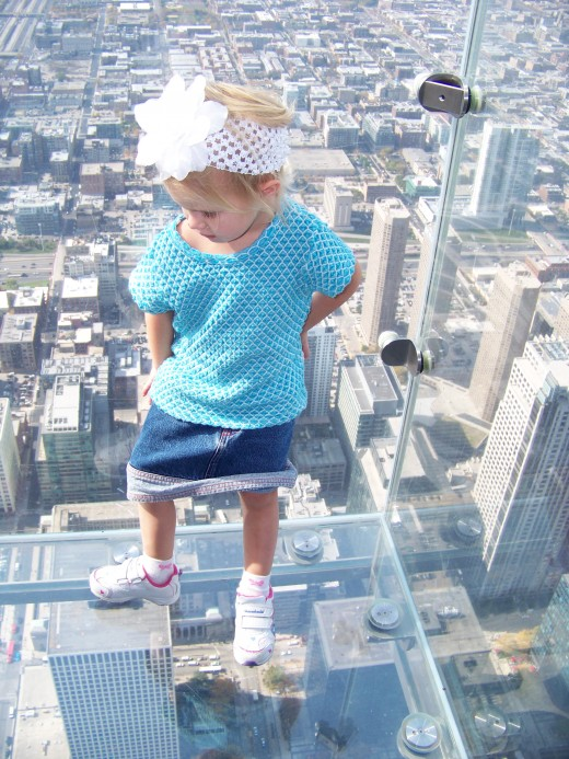 Clear glass slide-out off of the Willis Tower. My daughter standing looking down:)