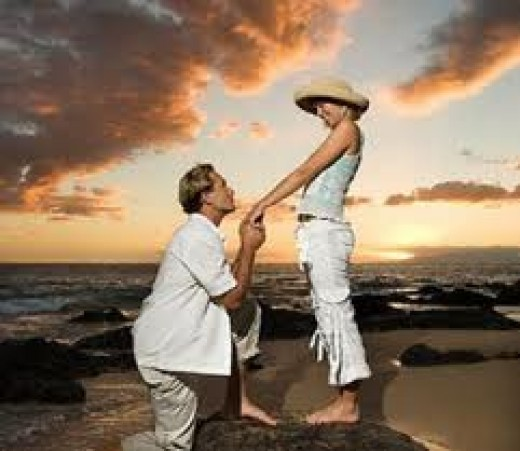 Yes, down on the knee, the standard way of proposing to your girl. And at sunset. Did you plan that, dude?