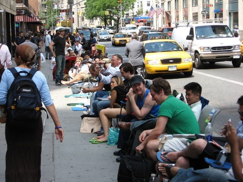 Eager iphone customers lining up outside a Broadway store in 2007