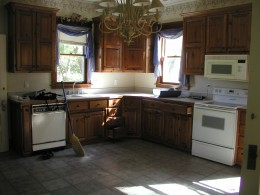 Updated but well done kitchen with solid knotty pine doors and cabinets, beautiful tile floor.
