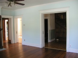 Large oversized double pocket doors leading from entry into living room