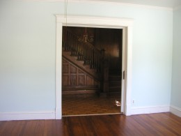 looking into entry way to staircase from living room