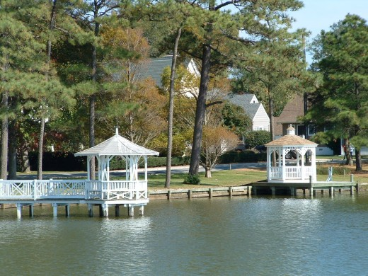 Gazebos as seen from the lake looking toward Lake Drive. Note how house in background is across the street from gazebos.