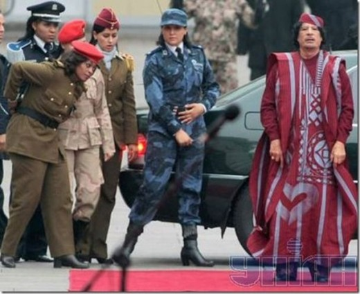 Ghadafi and body guard, high heels on guard visible