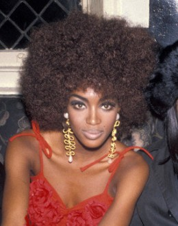 Naomi Campbell wearing a Afro Wig