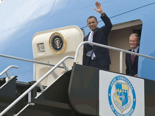 Barack Obama coming out of Air Force one.