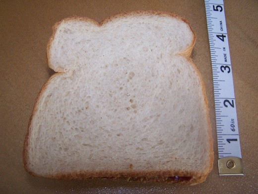 The length of the square is 4 inches, making the area of the whole square sandwich 16 sq. inches.