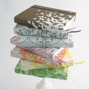 A stack of eco-friendly journals.