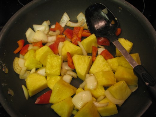 Add pineapple and stir fry until heated through.  Put aside in serving container while you cook the meat.