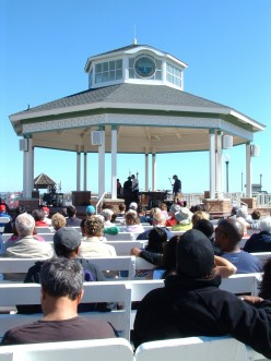 Rehoboth Beach Band Stand. Audience is facing the ocean and boardwalk as they enjoy the free concerts.