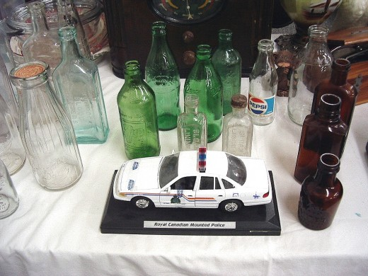 bottles and collectible car for auction