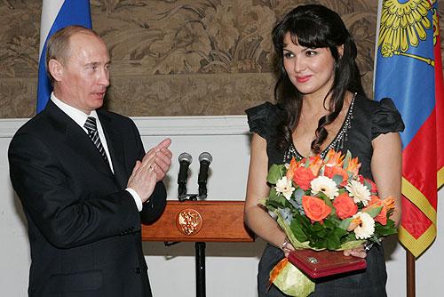 Russian soprano Anna Netrebko accepts the award of People's Artist of Russia from Premier Vladimir Putin in 2008.
