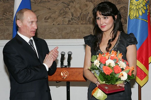 Russian soprano Anna Netrebko accepts the award of People's Artist of Russia from Premier Vladimir Putin in 2008.