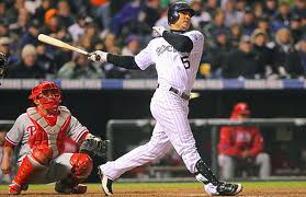 Carlos Gonzalez admire the results of his beautiful swing and quick hands.