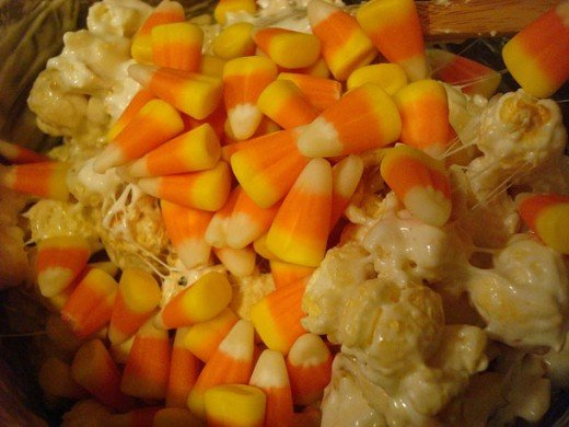 popcorn bars that are similar to this recipe, using candy corn as a decoration.